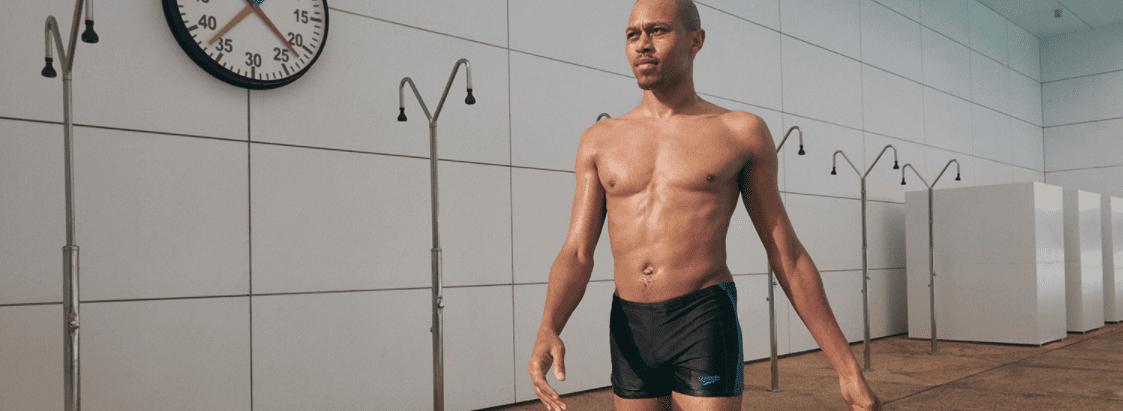 A man wearing Speedo swimming trunks