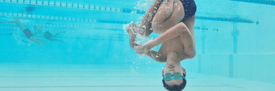 A boy wearing Speedo goggles in a swimming pool