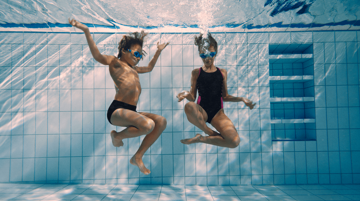Two young swimmers in a swimming pool