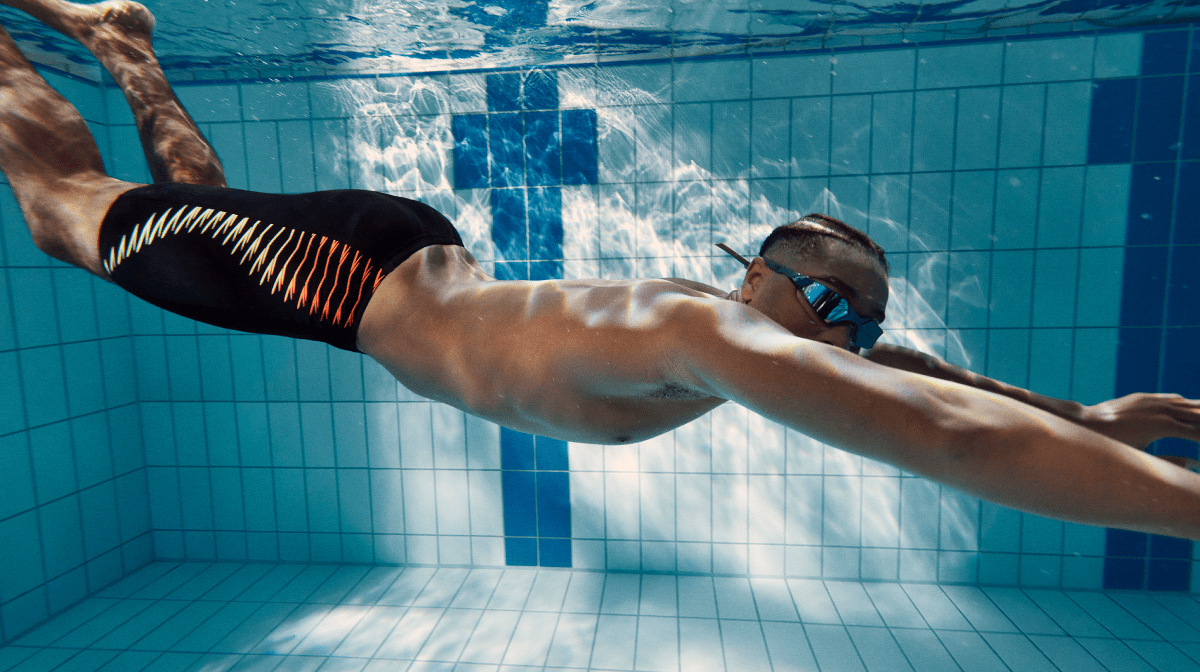 A man holding his breath while swimming underwater