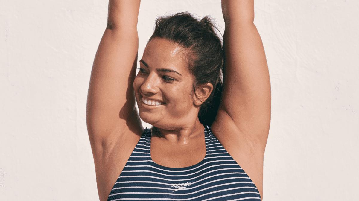A woman wearing a Speedo swimsuit