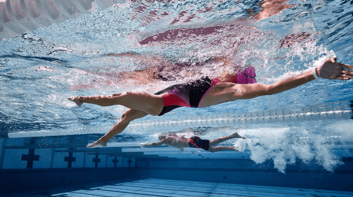 Two people completing a swim workout
