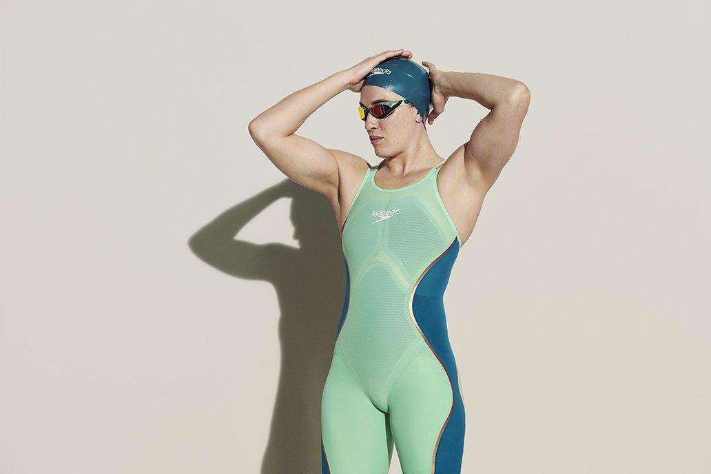 Sophie Pascoe puts her swim cap on carefully