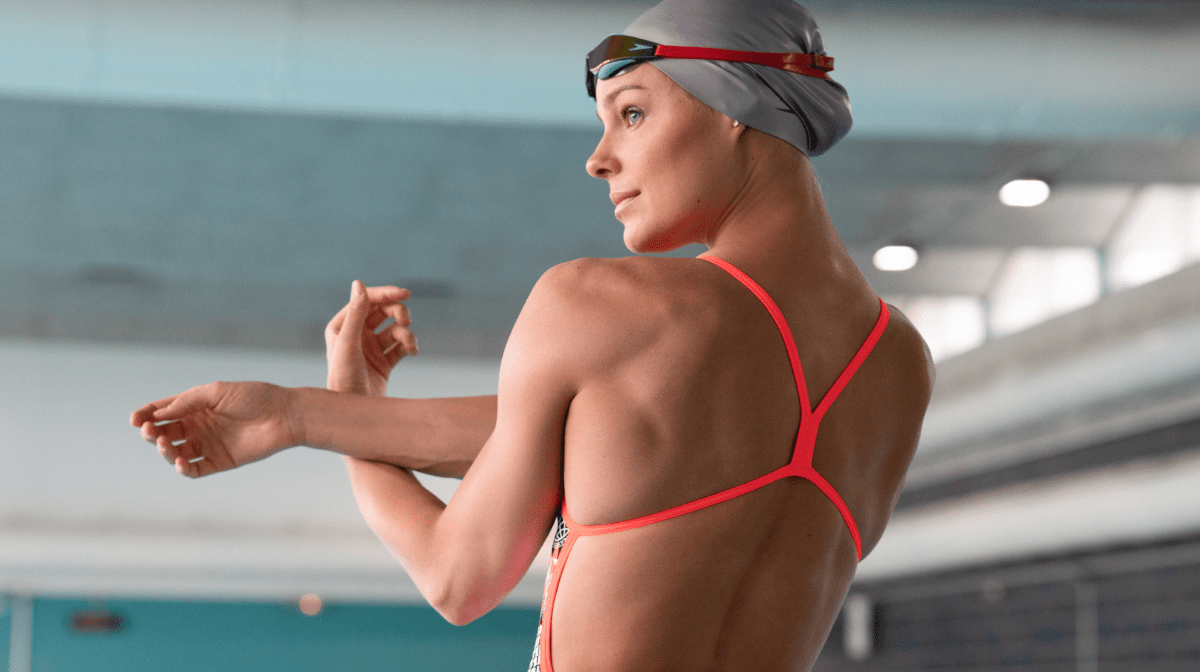 Pernille stretches before entering the pool