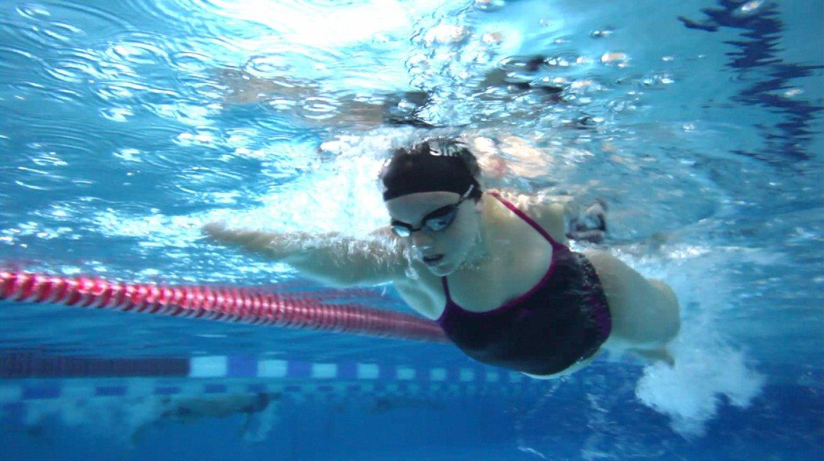 Ellie Simmons swimming in pool