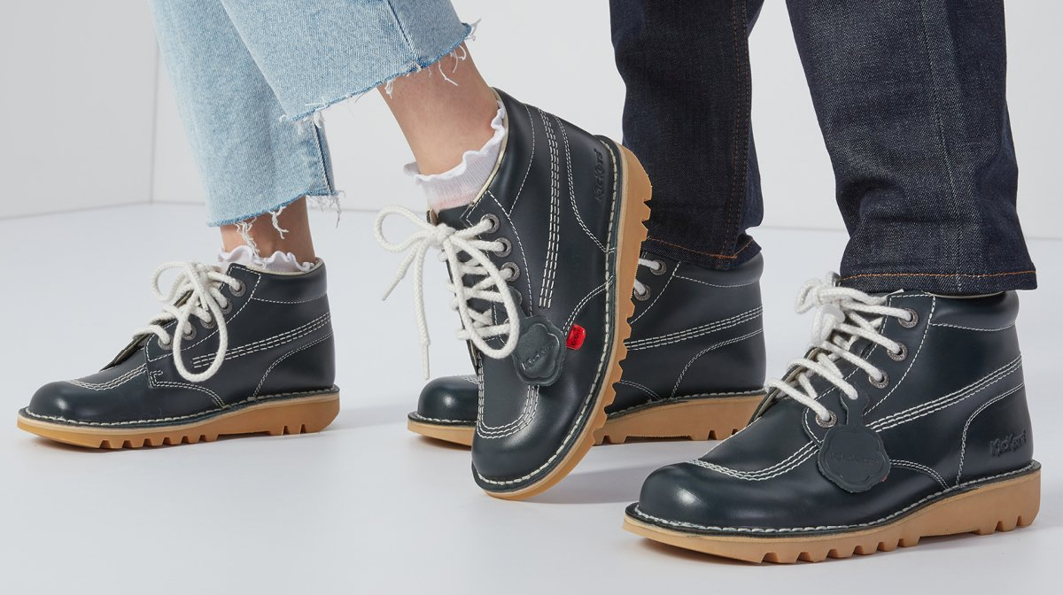Male and female shoes pose together