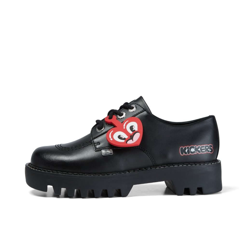 Black shoes with red heart tag on white background