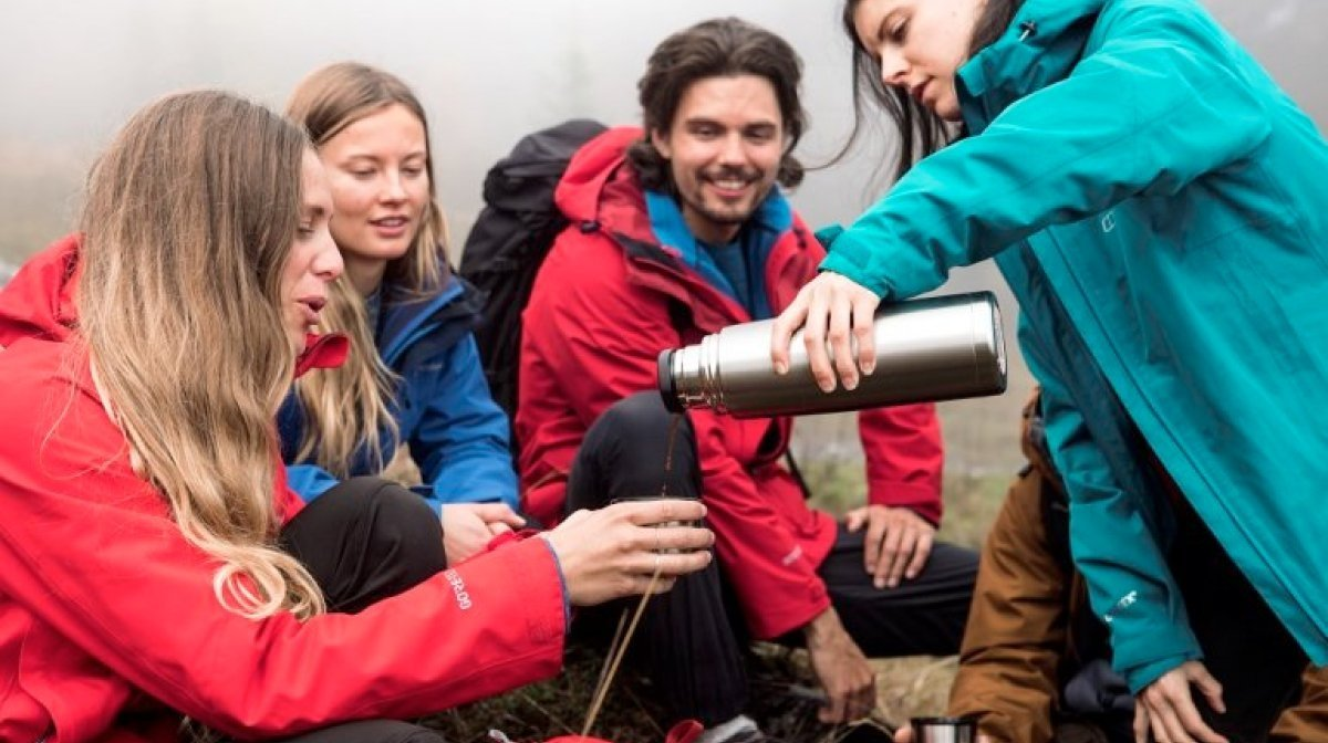 A group of friends wearing Berghaus interactive jackets