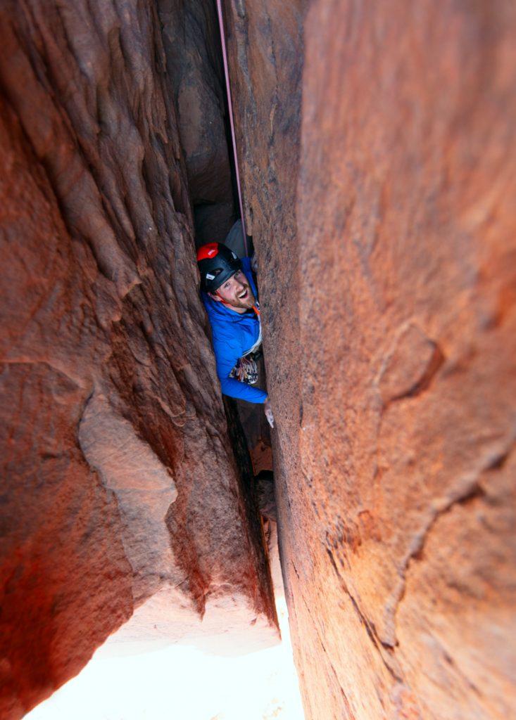 Waldo climbing in tight crack in rock wall