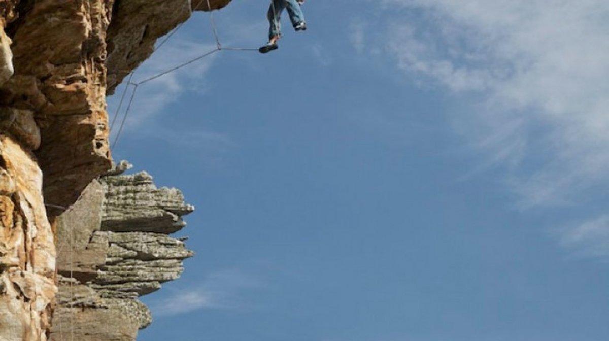 A man climbing an overhang
