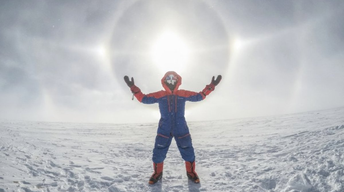 Ed Jackson climbing steep mountain cloaked in Berghaus gear
