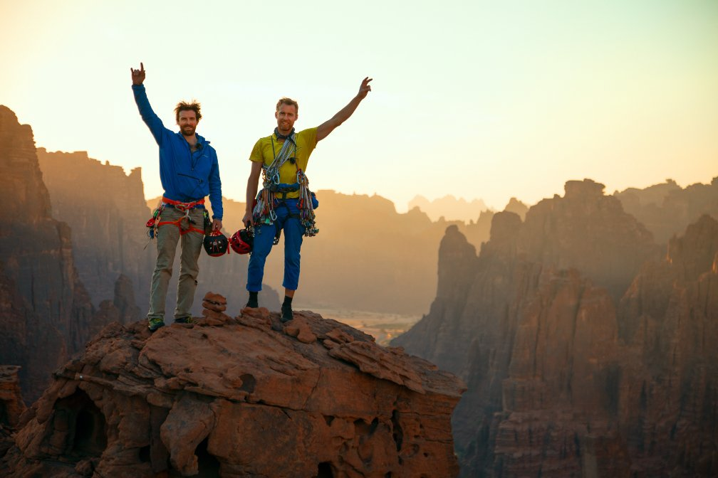 Duo celebrate atop cliff