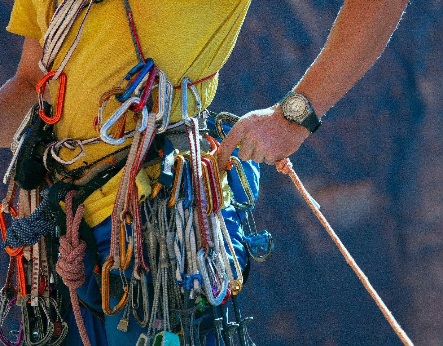 Countless ropes attached to climbers harness
