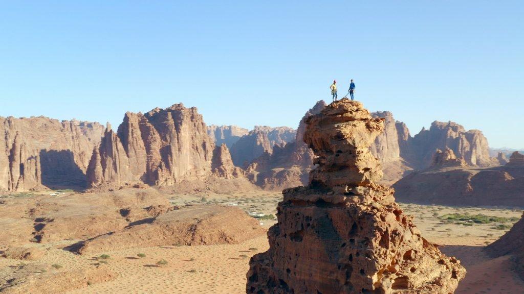 Duo pose atop Saudi rock tower