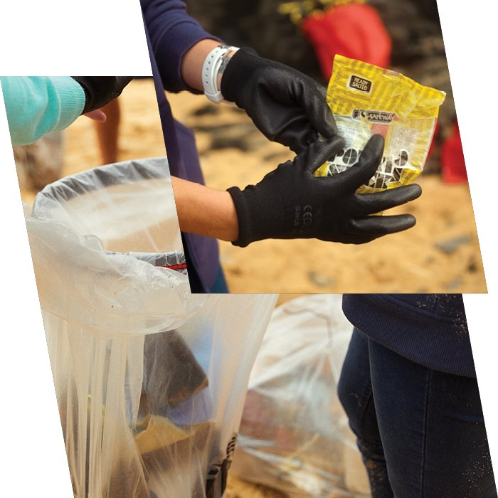 Person points to yellow bag of rubbish
