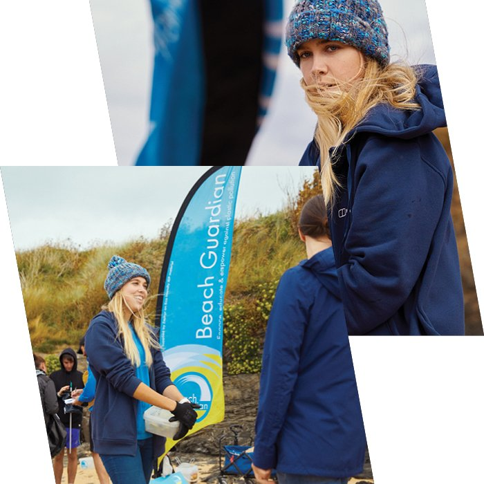 Emily standing and smiling in all blue Bergahus gear