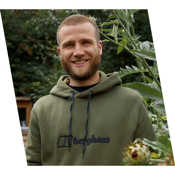 Smiling man in brown Berghaus jumper
