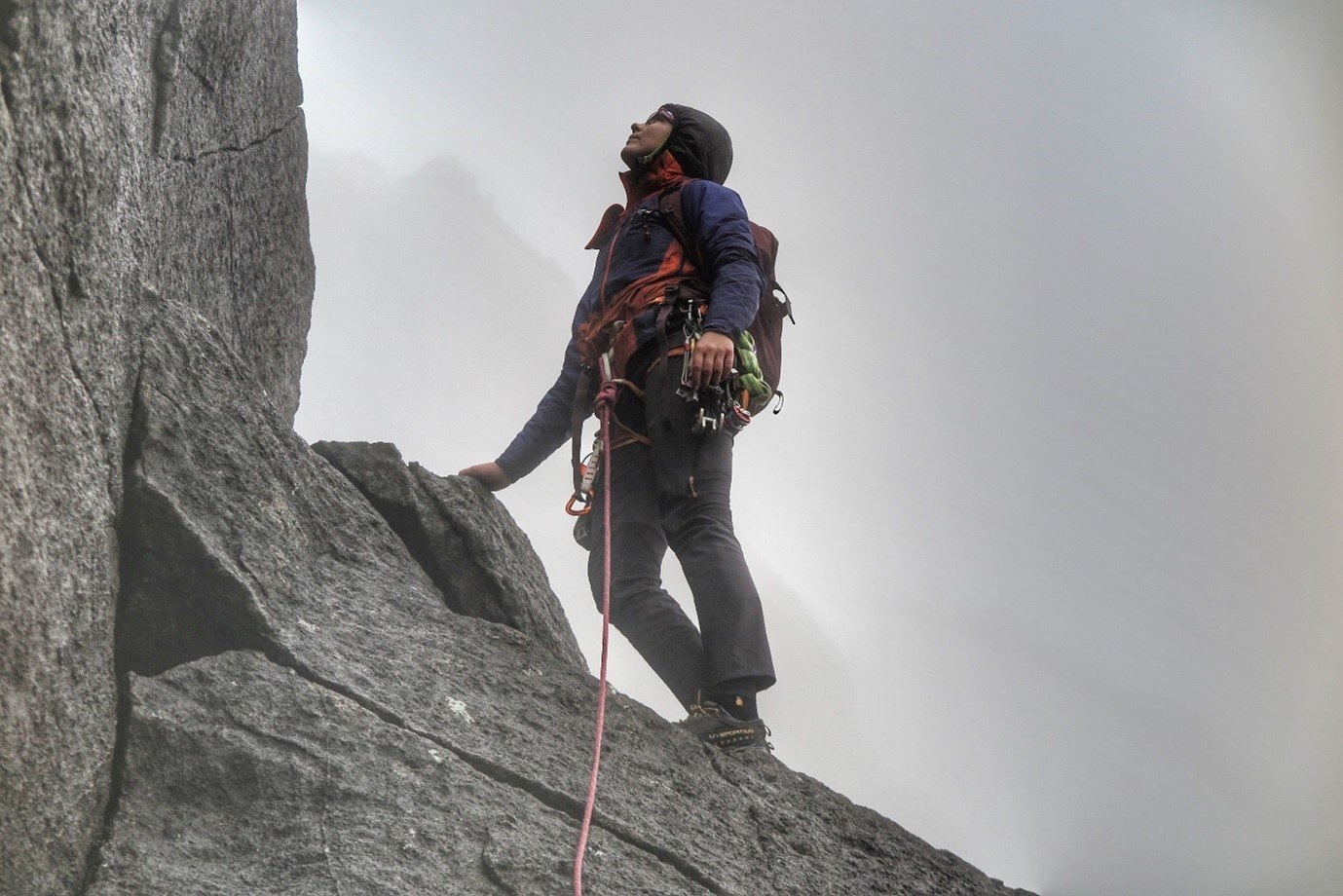 Anna stands atop cliff in Berghaus gear