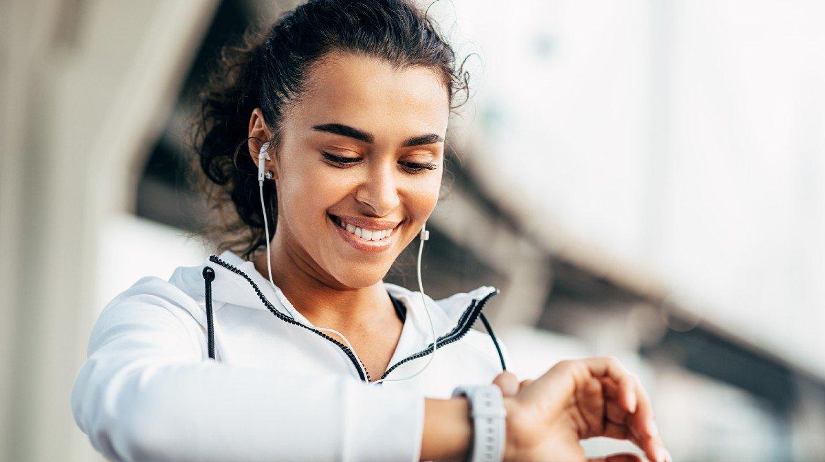 woman checking fitness watch run