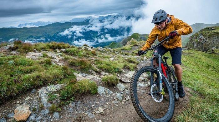 Man sits on bike atop a hill