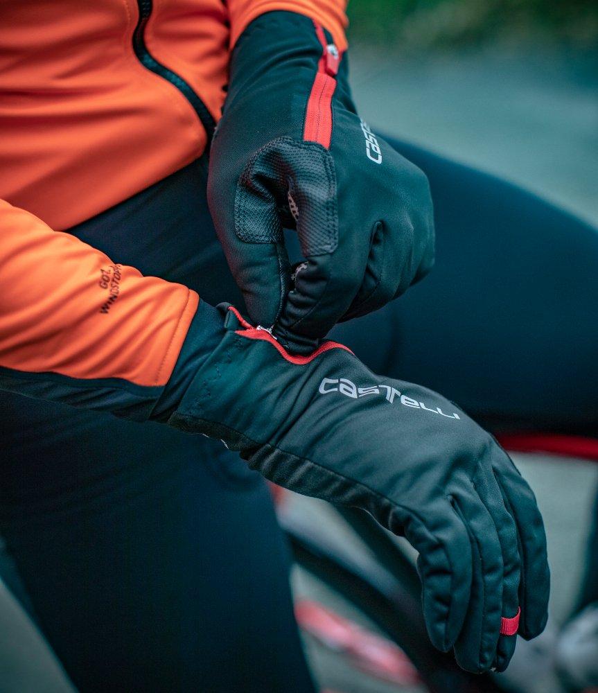 Man putting on Castelli 2019 winter gloves