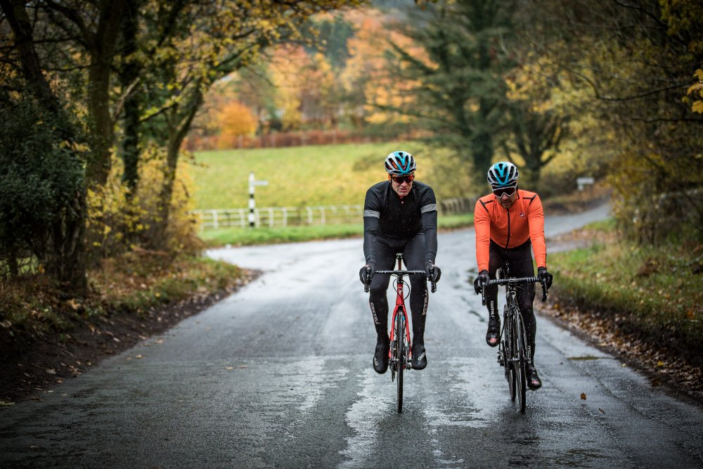 Two men cycling, wearing 2019 Castelli winter clothing