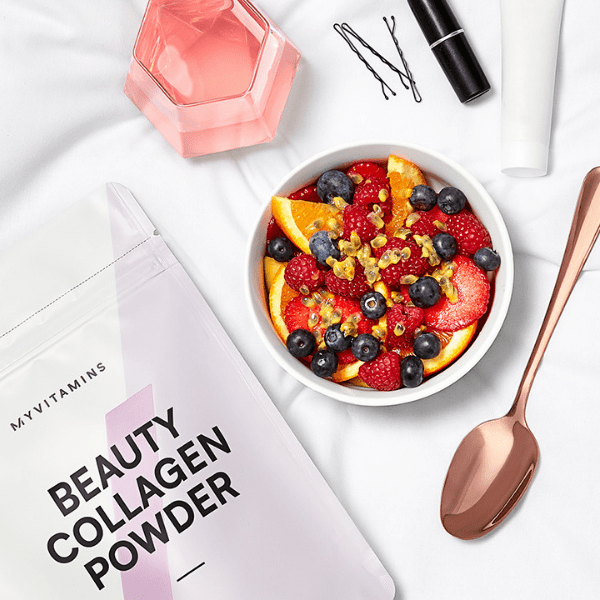 beauty collagen powder with fruit bowl and glass