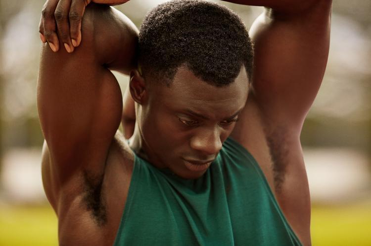 man stretching triceps