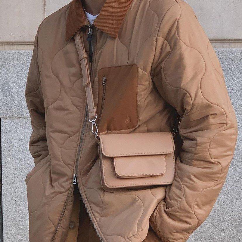 man wearing crossbody bag