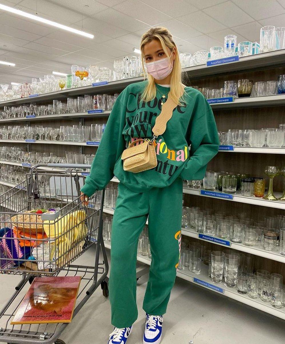 girl in supermarket wearing bag