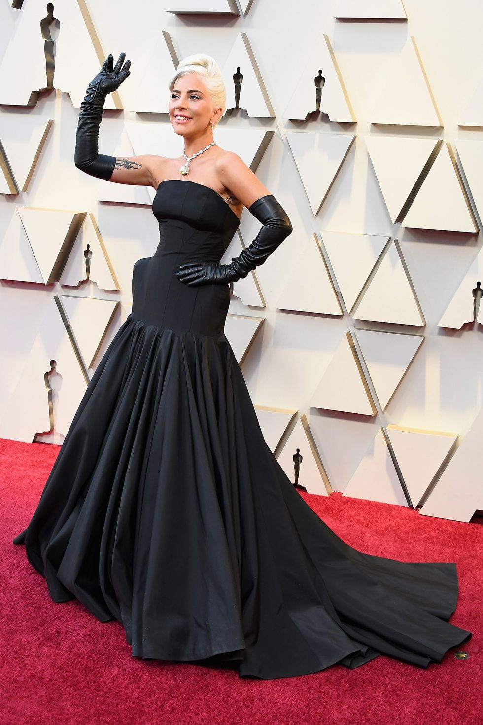Singer photographed on red carpet in long black gown