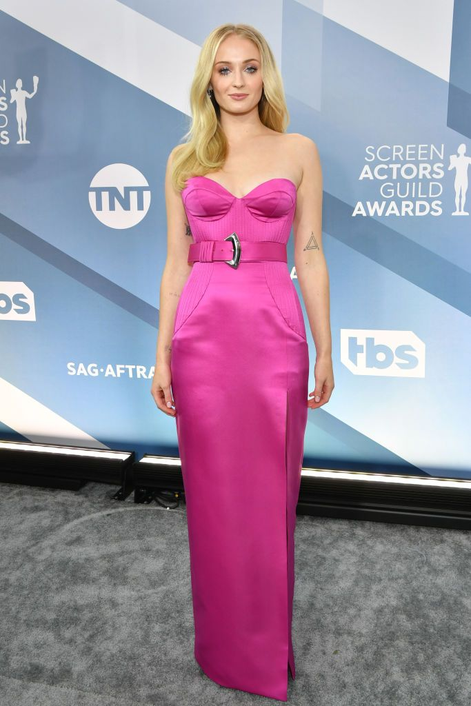 Actress in pink dress photographed at actor awards