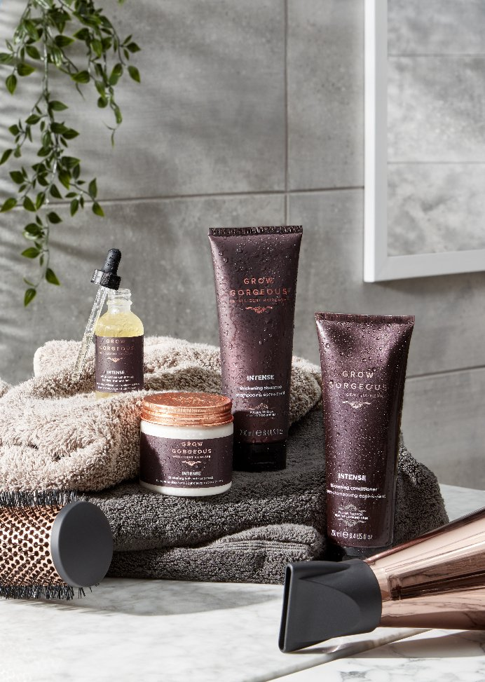 Grow Gorgeous full intense range with hairdryer and towels