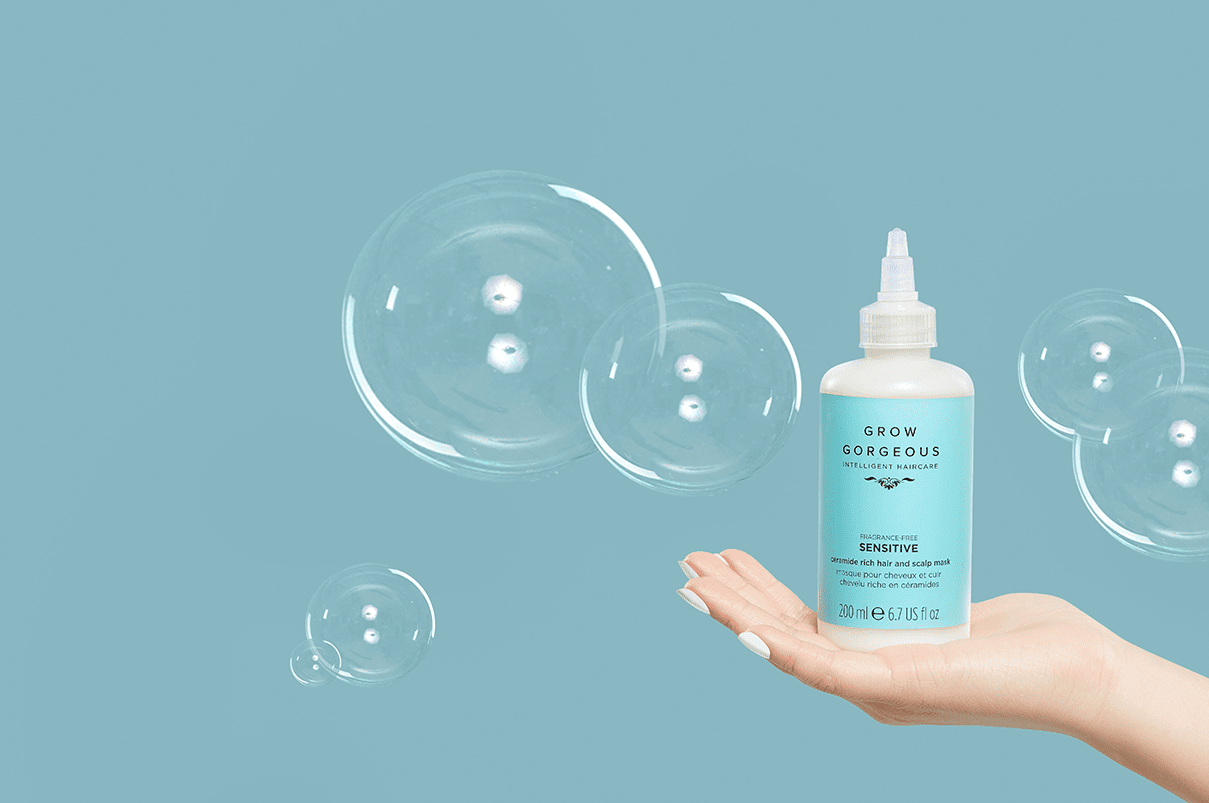 A hand holding up the best scalp treatment for dandruff the Grow Gorgeous sensitive ceramide rich hair and scalp mask.