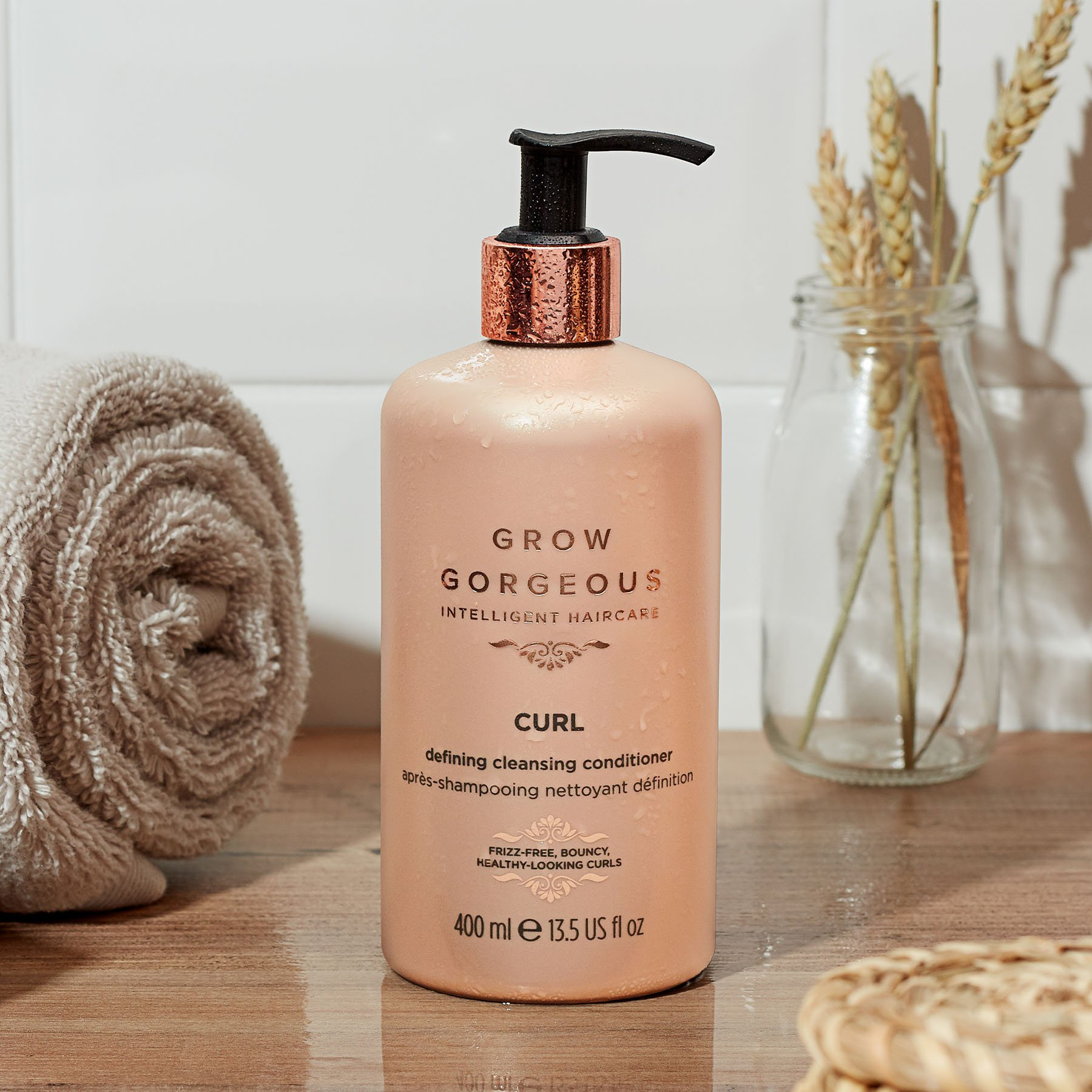 Grow Gorgeous Curl Defining Cleansing Conditioner bottle for co washing curly hair.