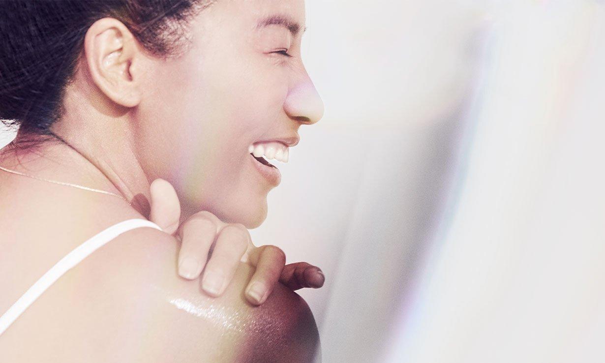 Laughing applying skincare
