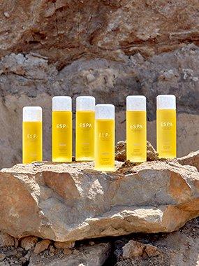ESPA body oils on a rock