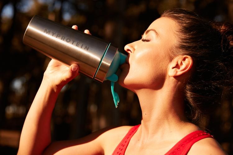 woman having post-workout drink