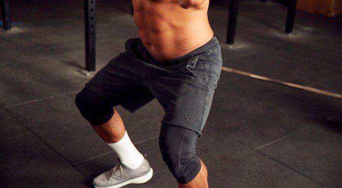 squatting in raw shorts