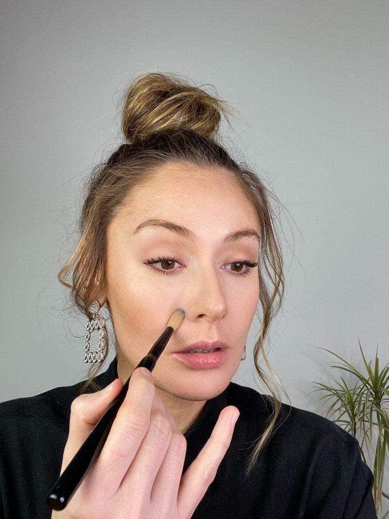 Makeup artist applying concealer