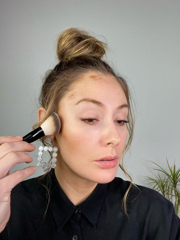 makeup artist applying contour stick