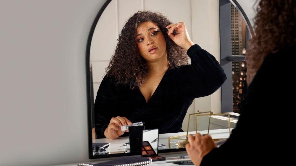 Woman applying Eyeko mascara
