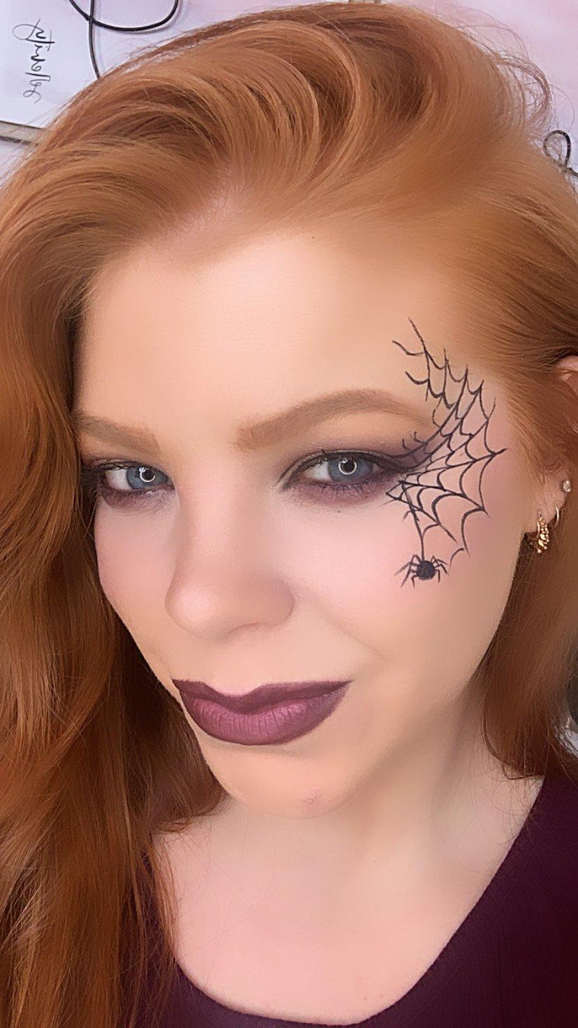 Halloween makeup with spider web