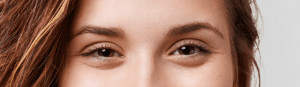 Model with down-turned eye shape