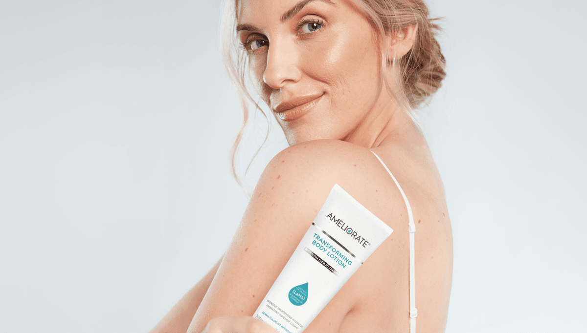 woman holding Ameliorate Transforming Body Lotion