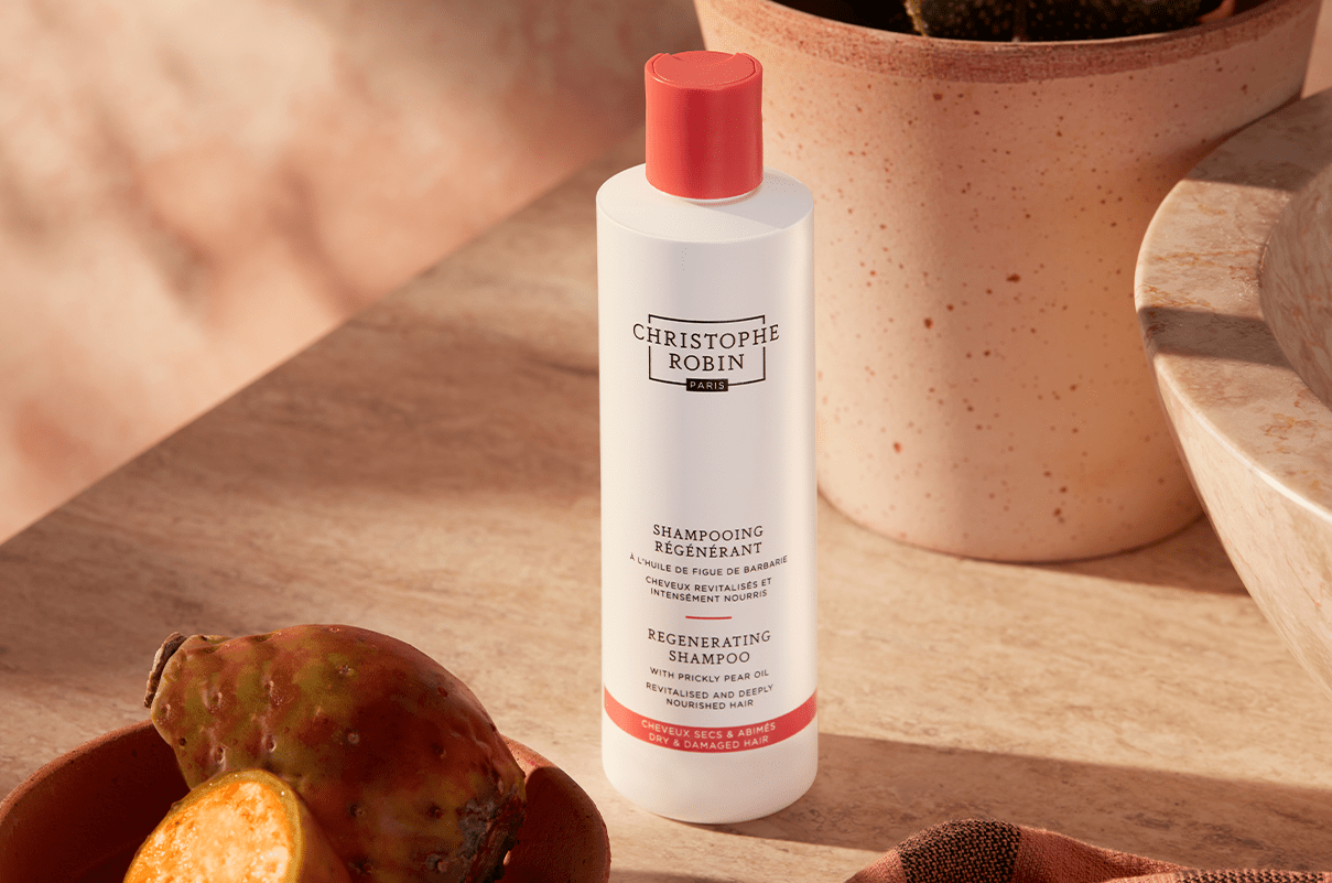 White bottle of the Regenerating Shampoo with Prickly Pear Oil containing the natural hair ingredient prickly pear