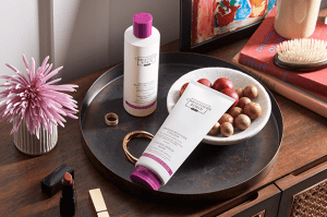Two salon worthy products by Christophe Robin's Colour Shield range. Two white bottles with pink accents.