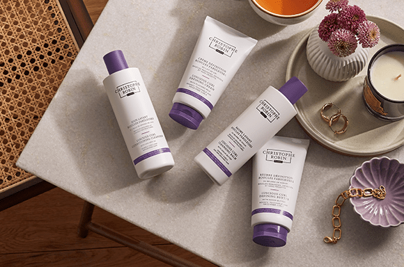 Four products from the luscious curl regimen for two different types of natural curls.