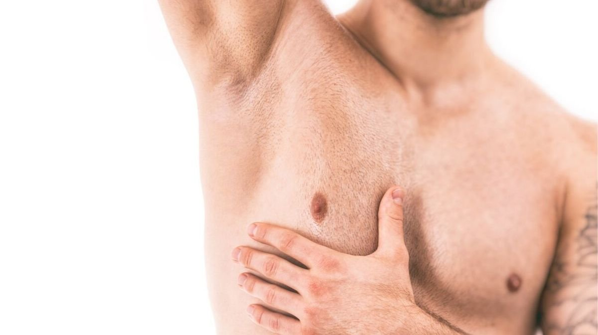 man showing smooth armpits after shaving