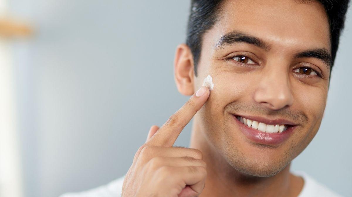 man applying moisturiser after shaving